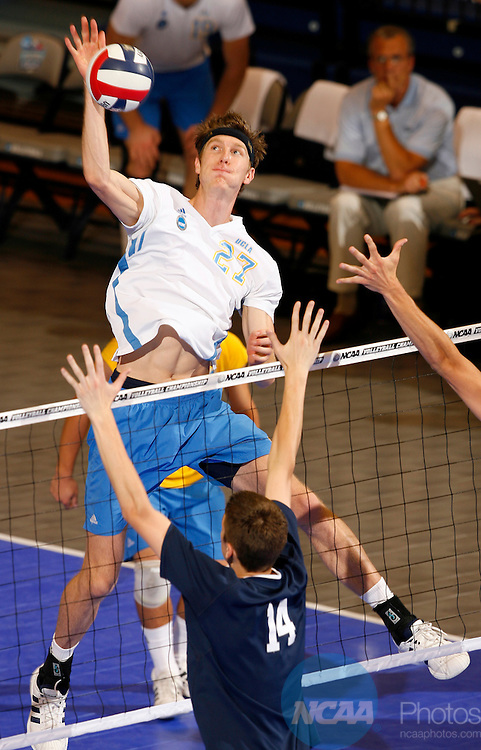 06 MAY 2006:   Nick Scheftic (27) of UCLA spikes the ball past Matt Anderson (14) of Penn State University during the Division I Men's Volleyball Championship held at Recreation Hall on the Penn State University campus in University Park, PA.  UCLA defeated Penn State 3-0 for the national title.  Jamie Schwaberow/NCAA Photos