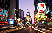 Times Square at night with streaks of traffic,    New York City, USA