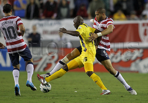 08.06.2012. Tampa, Florida, USA.  Oguchi Ontewu (5) of USA MNT tackles Peter Byers (16) of Antigua & Barbuda during a 2014 FIFA World Cup qualifying match at Raymond James Stadium in Tampa, Florida. USA won 3-1.