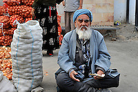 Portrait of an onion vendor
