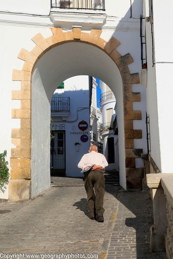 Traditional whitewashed buildings in Vejer de la Frontera, Cadiz Province, Spain old man walking in street