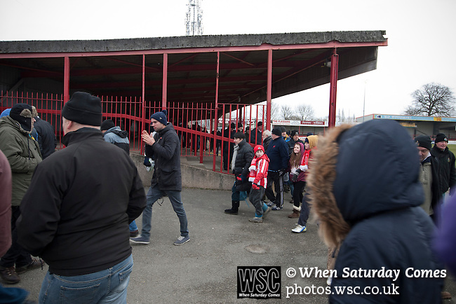 Altrincham 2 Worcester City 0, 23/03/2013. Moss Lane, Blue Square Bet North. The home fans heading for the exits at the conclusion of the the Blue Square Bet North fixture between Altrincham (in red) and Worcester City at Moss Lane, Altrincham. The home team won the match 2-0 watched by 777 spectators on a day when most non-League football in England was cancelled due to adverse weather. Altrincham were historically one of the major English non-League teams but have never been promoted to the Football League. Photo by Colin McPherson.