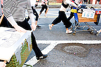 Teams race in the third annual Idiotarod in New York City on January 28, 2006.  <br /> <br /> The playfully named Idiotarod is a race between teams of five people pulling stylized shopping carts, starting in the borough of Brooklyn and ending in Manhattan.  Teams are given only checkpoints and must devise their own routes to make it to each finish line.  Awards are not only given to the first finishers but also to those with the best costumes, best bribes, and most creative sabotage techniques.  Imbibing of alcohol or other substances is neither required nor discouraged and the race is administered by the mysterious group C.O.B.R.A. (Carts of Brooklyn Racing Association).