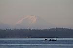Canoe Journey, Paddle to Nisqually, 2016, Northwest tribal canoes paddling at sunrise, Salish Sea, Mount Rainier, Marrowstone Island, Olympic Peninsula, Puget Sound, Washington State, USA,