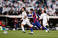 1st March 2020; Estadio Santiago Bernabeu, Madrid, Spain; La Liga Football, Real Madrid versus Club de Futbol Barcelona; Lionel Messi (FC Barcelona) and Marcelo of Real chase the loose ball