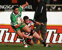 Manawatu second five Frankie Bryant beats Mark Selwyn to score during the Air NZ Cup rugby match between Manawatu Turbos and Counties-Manukau Steelers at FMG Stadium, Palmerston North, New Zealand on Sunday, 2 August 2009. Photo: Dave Lintott / lintottphoto.co.nz