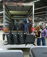 Julie Hall (from left), Vivki Penny and Sharon Rose with the Benton County Election Commission load voting machines and other equipment Thursday, Feb. 13, 2020, into a truck at the Benton County Election Commission office in Rogers. Staff began distributing equipment Thursday to the 36 vote centers for the March 3 primary election. Check out nwaonline.com/200214Daily/ for today's photo gallery.<br /> (NWA Democrat-Gazette/Ben Goff)