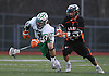 Brian Michael #18 of Farmingdale, left, scoops up a loose ball after facing off against Joe Petrancosta #24 of Carey during a non-league varsity boys lacrosse game at Farmingdale High School on Friday, Apr. 8, 2016.
