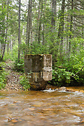 Remnants of the Anderson Brook Gage from the 1911 study at Stillwater Junction in the Pemigewasset Wilderness of the New Hampshire White Mountains. A timber bridge of the old East Branch & Lincoln Logging Railroad (1893-1948) was located just downstream (left side) from this Gage abutment. The bridge crossed the brook at an angle, and this branch of the railroad lead to Camp 19. This abutment has fallen over since this photo was taken.