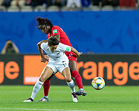 GRENOBLE, FRANCE - JUNE 15: Sarah Gregorius #11 of the New Zealand National Team attempts to control the ball as Kadeisha Buchanan #3 of the Canadian National Team pressures during a game between New Zealand and Canada at Stade des Alpes on June 15, 2019 in Grenoble, France.