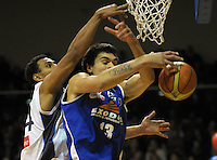 Saints forward Steve Adams beats Mika Vukona to a defensive rebound. NBL Semifinal - Wellington Saints v Nelson Giants at TSB Bank Arena, Wellington, New Zealand on Friday, 15 July 2011. Photo: Dave Lintott / lintottphoto.co.nz