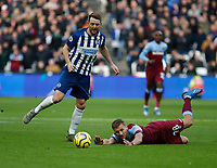 1st February 2020; London Stadium, London, England; English Premier League Football, West Ham United versus Brighton and Hove Albion; Tomas Soucek of West Ham United falls to the ground after being fouled by Dale Stephens of Brighton and Hove Albion