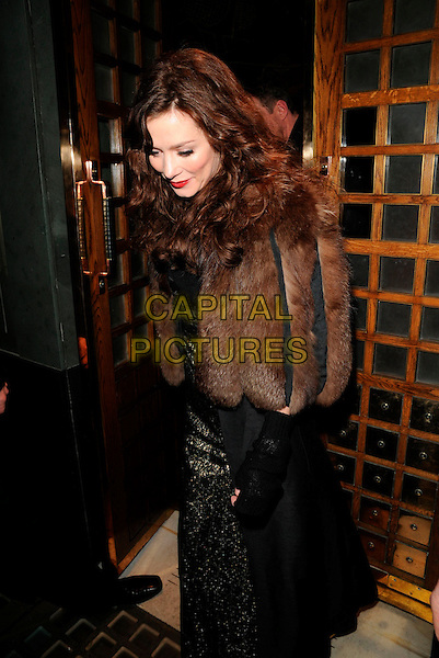 ANNA FRIEL .At The Ivy Restaurant, London, England,.February 2nd 2008..half length brown fur coat jacket black and gold dress red lipstick.CAP/CAN.?Can Nguyen/Capital Pictures