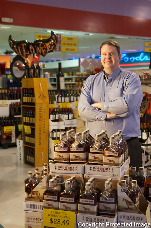 Brad Williams runs the largest and the highest volume liquor chain, Liquor Barn, in Kentucky. When his store puts a bottle of whiskey on the shelf, it sells quickly. Here, he stands behind a new brand in Lexington Bourbon. So far, it's sold well, he says.