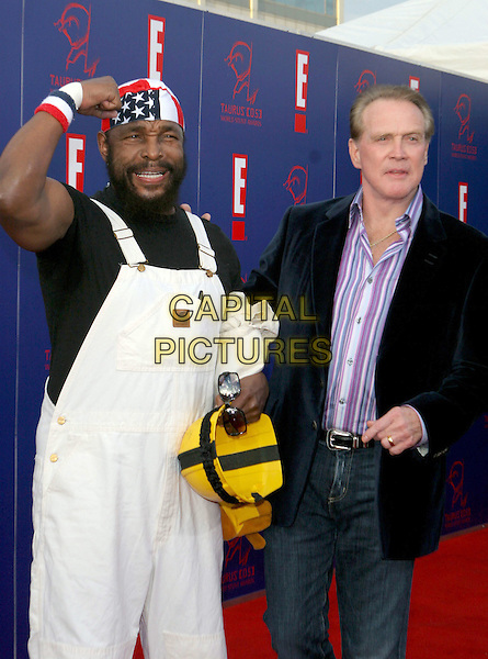 MR. T & LEE MAJORS.5th Annual Taurus Stunt Awards held at Paramount Pictures, Los Angeles,  CA..September 25th, 2005.Photo credit: Jacqui Wong/AdMedia/Capital Pictures.Ref: JW/ADM/CAP.half length bandana stars & stripes white overalls dungarees beard facial hair flexing muscles.www.capitalpictures.com.sales@capitalpictures.com.© Capital Pictures.