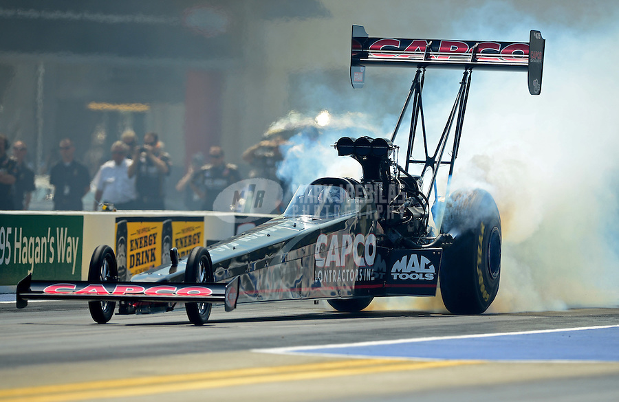 Apr. 15, 2012; Concord, NC, USA: NHRA top fuel dragster driver Steve Torrence during eliminations for the Four Wide Nationals at zMax Dragway. Mandatory Credit: Mark J. Rebilas-