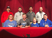 RICK PECK/SPECIAL TO MCDONALD COUNTY PRESS<br /> McDonald County High School's Charley Moore (bottom, second from left) recently signed a letter of intent to pitch at Crowder College. Shown above (front, left) is Sheri Moore (Mother), Charley Moore, Izzy Moore (Sister) and David Moore (Father); (back, left), are MCHS baseball coaches Heath Alumbaugh, Kellen Hoover, Kevin Burgi and Bo Bergen.