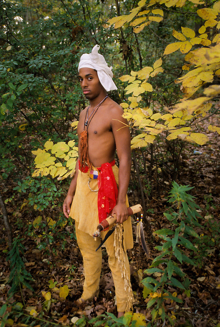 Young Cherokee man dressed in traditional buckskin leggings and breechcloth also wears the traditional turban that was common in the early 1800's.