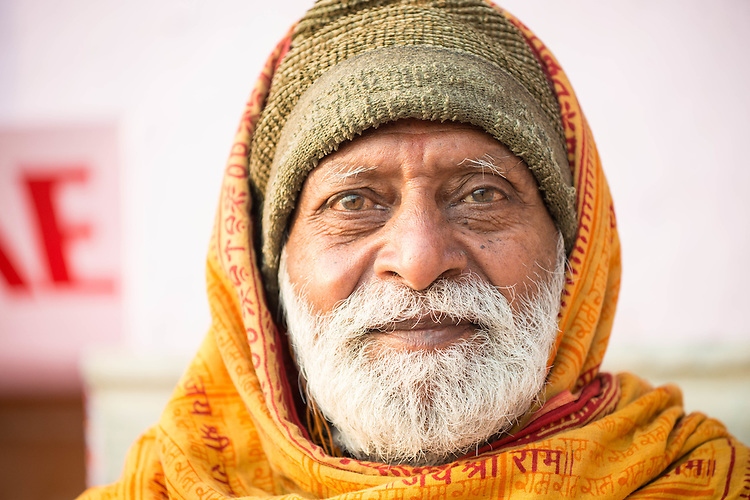 Holy man in Varanasi sitting in the stairs facing the ganges river-