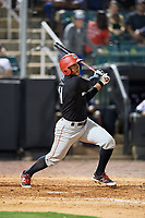 Chattanooga Lookouts right fielder Edgar Corcino (11) follows through on a swing during a game against the Jackson Generals on April 29, 2017 at The Ballpark at Jackson in Jackson, Tennessee.  Jackson defeated Chattanooga 7-4.  (Mike Janes/Four Seam Images)