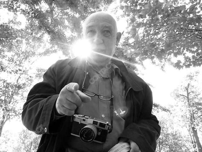 Film-maker/photographer Raymond Depardon shooting footage at the Vietnam Memorial. Washington, D.C., June 2, 2008.