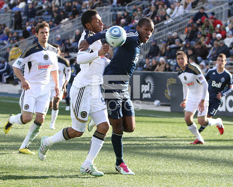 Carlos Valdes#5 of the Philadelphia Union challenges Atiba Harris#9 of the Vancouver Whitecaps during an MLS match at PPL Park in Chester, PA. on March 26 2011. Union won 1-0.