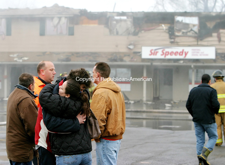 WATERBURY, CT. 17 February 2006-021706SV03--Shop owners and workes console each other as Waterbury firefighters work to contain a large fire that destroyed their businesses at 1215 Thomaston Ave. in Waterbury early Friday.<br /> Steven Valenti Republican-American