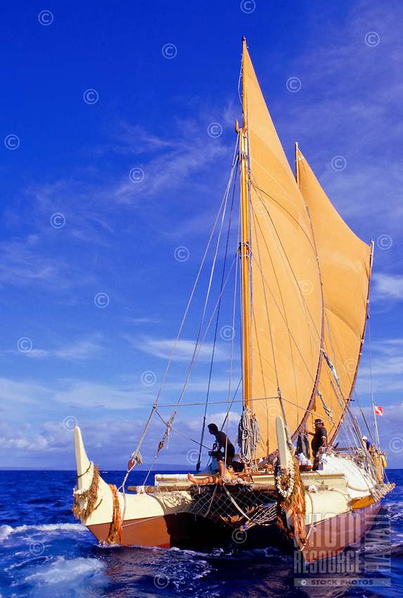 Polynesian voyaging canoe Hokulea in open ocean off the island of Molokai