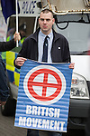 "© Joel Goodman - 07973 332324 . NO SYNDICATION PERMITTED . 21/03/2015 . Newcastle , UK . A man carrying a "" British Movement "" poster . Neo-Nazis and skinheads from across Europe organise a "" White Man March "" in Newcastle , under the banner of "" National Action "" . Photo credit : Joel Goodman"