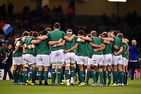 The Ireland team huddle together during the pre-match warm-up. Rugby World Cup Pool D match between France and Ireland on October 11, 2015 at the Millennium Stadium in Cardiff, Wales. Photo by: Patrick Khachfe / Onside Images