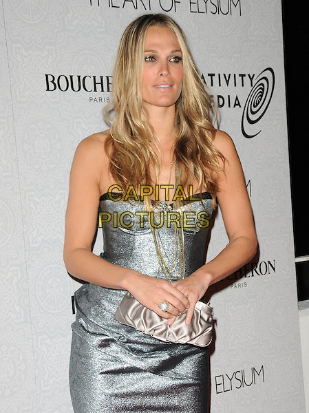 "MOLLY SIMS.Art of Elysium 3rd Annual Black Tie charity gala '""Heaven"" held at 990 Wilshire Blvd in Beverly Hills, California, USA, .January 16th 2010 .half length silver gold necklace bustier straps chain strapless grey gray clutch bag.CAP/RKE/DVS .©DVS/RockinExposures/Capital Pictures"