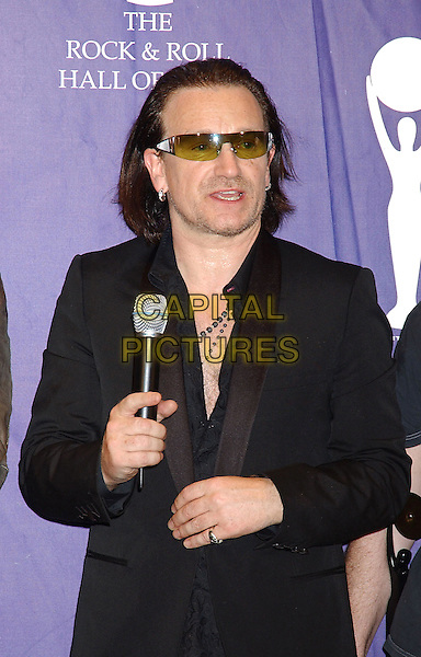 BONO - U2.2005 Rock and Roll Hall of Fame Induction Ceremony held at the Waldorf Astoria, New York, New York.half length stubble facial hair sunglasses shades earrings piercings microphone.www.capitalpictures.com.sales@capitalpictures.com.© Capital Pictures.