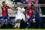 21 October 2016: Notre Dame's Oliver Harris (18) is defended by Duke's Suniel Veerakone (10) and Cody Brinkman (25). The Duke University Blue Devils hosted the University of Notre Dame Fighting Irish at Koskinen Stadium in Durham, North Carolina in a 2016 NCAA Division I Men's Soccer match. Duke won the game 2-1 in two overtimes.