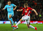 Luke Shaw of Manchester United takes on Jens Toornstra of Feyenoord during the UEFA Europa League match at Old Trafford, Manchester. Picture date: November 24th 2016. Pic Matt McNulty/Sportimage