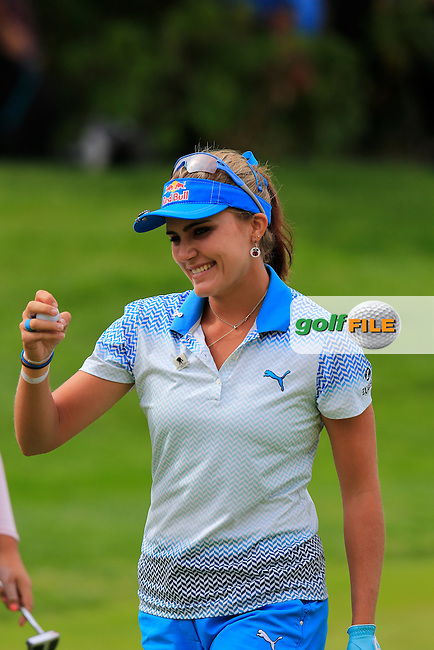 Lexi Thompson (USA) sinks her birdie putt on the 5th green during Sunday's Final Round of the LPGA 2015 Evian Championship, held at the Evian Resort Golf Club, Evian les Bains, France. 13th September 2015.<br /> Picture Eoin Clarke | Golffile