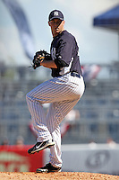 New York Yankees pitcher Dan Burawa #92 delivers a pitch during a scrimmage against the USF Bulls at Steinbrenner Field on March 2, 2012 in Tampa, Florida.  New York defeated South Florida 11-0.  (Mike Janes/Four Seam Images)
