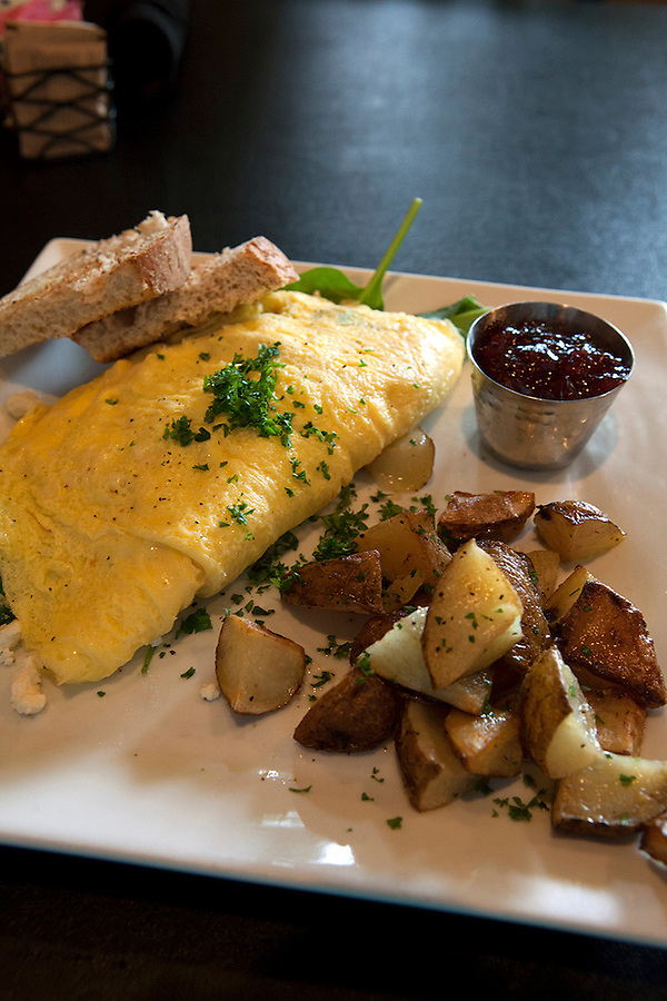 Omelette, home fries and toast at The Twisted Olive Restaurant, Petosky, Michigan, MI, USA