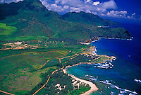Aerial over Mahaulepu Beach and cove after Shipwreck Beach beyond the end of the paved road Poipu area, South shore of Kauai