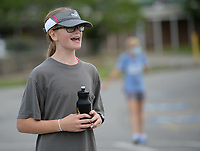 Emmay Burney, 12, a seventh-grader and member of the West Fork cross country team, encourages teammates Friday, July 31, 2020, during practice at West Fork Elementary School. The team ran relay drills while observing social-distancing requirements. Visit nwaonline.com/200801Daily/ for today's photo gallery.<br /> (NWA Democrat-Gazette/Andy Shupe)
