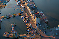 A ship is supplied with grain from the Bunge grain silo in Quebec city in this aerial photo November 11, 2009.