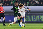 01.12.2019, Volkswagen Arena, Wolfsburg, GER, 1.FBL, VfL Wolfsburg vs SV Werder Bremen<br /><br />DFL REGULATIONS PROHIBIT ANY USE OF PHOTOGRAPHS AS IMAGE SEQUENCES AND/OR QUASI-VIDEO.<br /><br />im Bild / picture shows<br />Maximilian Arnold (VfL Wolfsburg #27) im Duell / im Zweikampf mit <br />Yuya Osako (Werder Bremen #08), <br /><br />Foto © nordphoto / Ewert