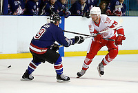 Ben Osborne (R) of Haringey takes on Andrew Cox during the National Ice Hockey League South Division 2 Cup - Group B game between Haringey Racers and Slough Jets at Alexandra Palace, London on Sat Sept 13, 2014.
