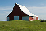 Norman Kemper's new red metal barn with US flag painted on the side, rural Iowa