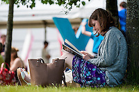 Tuesday 31 May 2016. Hay on Wye, UK<br /> Pictured: A woman relaxes in the sun at the Hay Festival <br /> Re: The 2016 Hay festival take place at Hay on Wye, Powys, Wales