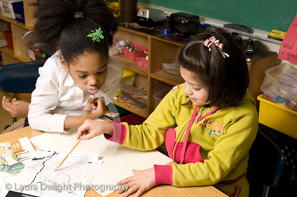 Elementary School New York Grade 2 science social studies two girls working together on project horizontal