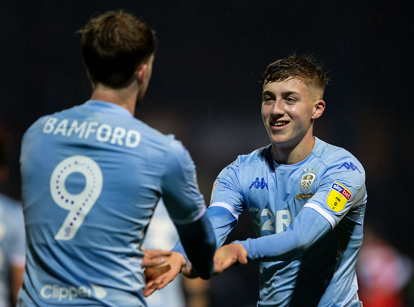 Leeds United's Patrick Bamford celebrates with Jack Clarke after his side got a late winner courtesy of a Matty Pearson own goal<br /> <br /> Photographer Alex Dodd/CameraSport<br /> <br /> The EFL Sky Bet Championship - 191123 Luton Town v Leeds United - Saturday 23rd November 2019 - Kenilworth Road - Luton<br /> <br /> World Copyright © 2019 CameraSport. All rights reserved. 43 Linden Ave. Countesthorpe. Leicester. England. LE8 5PG - Tel: +44 (0) 116 277 4147 - admin@camerasport.com - www.camerasport.com