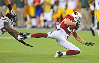 Aug. 28, 2009; Glendale, AZ, USA; Arizona Cardinals wide receiver Jerheme Urban (right) is tackled by Green Bay Packers safety (20) Atari Bigby during a preseason game at University of Phoenix Stadium. Mandatory Credit: Mark J. Rebilas-