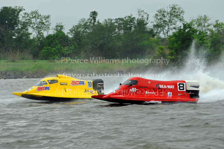 Terry Rinker (#10) and Shaun Torrente (#8) race out of turn 2.   (Formula 1/F1/Champ class)