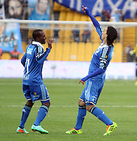 BOGOTA -COLOMBIA. 19-04-2014. Rafael Robayo (Der)  de Millonarios  celebra su gol  contra el Deportes Tolima  partido por la fecha 18 de La liga Postobon 1 disputado en el estadio Nemesio Camacho El Campin. /    Rafael Robayo (R)  of Millonarios  celebrates his goal against Deportes Tolima  match date 18 The Postobon one league match at the Estadio Nemesio Camacho El Campin. . Photo: VizzorImage/ Felipe Caicedo / Staff