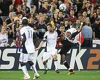 Rodney Wallace #22 of D.C. United kicks the ball over the head of Zack Schilawski #15 of the New England Revolution during an MLS match on April 3 2010, at RFK Stadium in Washington D.C.